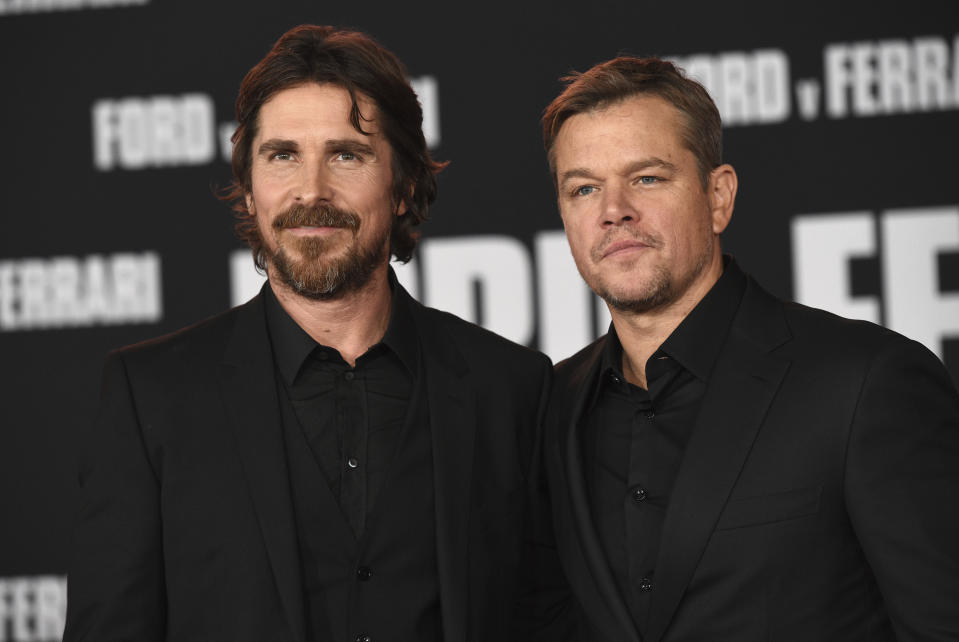 """Christian Bale, left, and Matt Damon arrive at a special screening of """"Ford v Ferrari"""" on Monday, Nov 4, 2019, at the TCL Chinese Theatre in Los Angeles. (Photo by Chris Pizzello/Invision/AP)"""