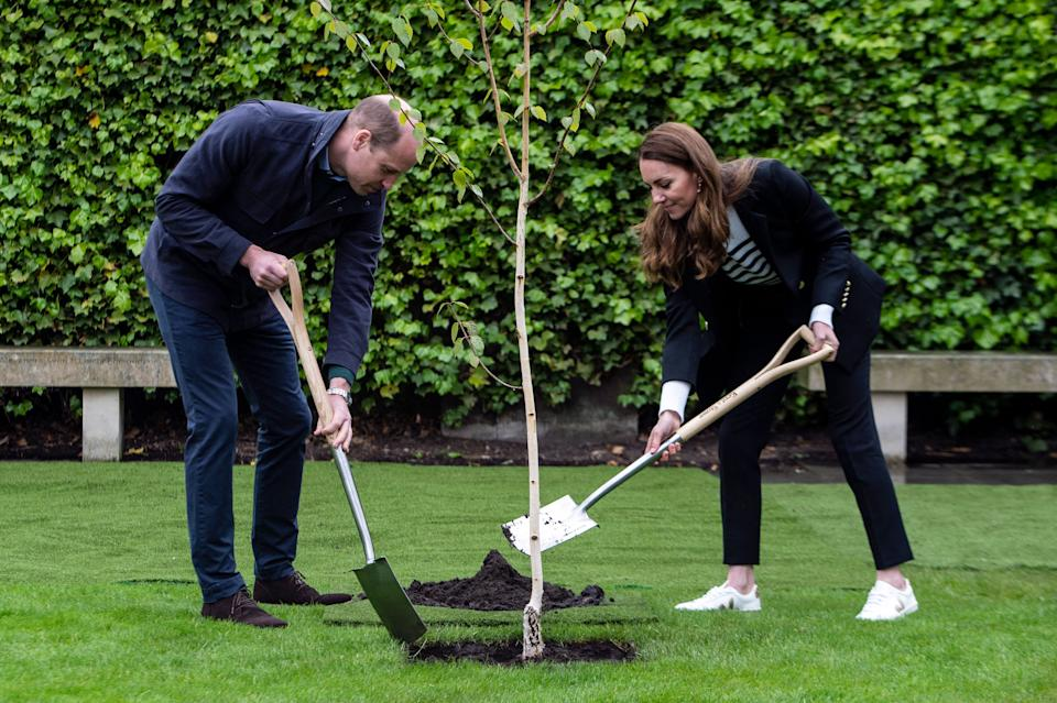 Britain's Catherine, Duchess of Cambridge and Britain's Prince William, Duke of Cambridge, take part in a tree planting ceremony as they visit the University of St Andrews in St Andrews on May 26, 2021. (Photo by Andy Buchanan / POOL / AFP) (Photo by ANDY BUCHANAN/POOL/AFP via Getty Images)