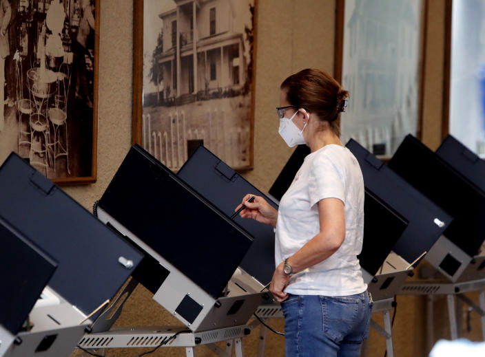 Amid concerns of the spread of COVID-19, a voter looks over their selection at a polling station, Tuesday, July 14, 2020, in Richardson, Texas. (LM Otero/AP)