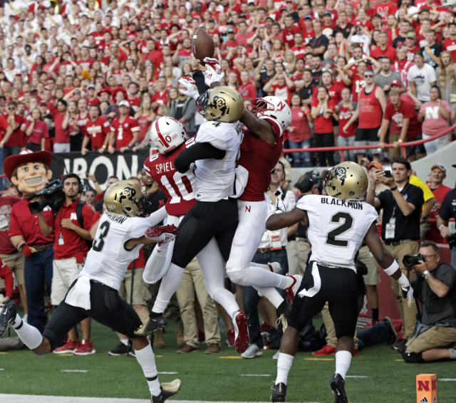 Colorado defensive backs Ronnie Blackmon (2) and Derrion Rakestraw (3) watch as defensive back Dante Wigley (4) breaks up a pass in the end zone intended for Nebraska wide receivers Stanley Morgan Jr. (8) and JD Spielman (10) during the second half of an NCAA college football game in Lincoln, Neb., Saturday, Sept. 8, 2018. Colorado won 33-28. (AP Photo/Nati Harnik)