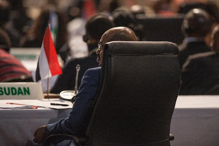 Sudanese President Omar al-Bashir attends the opening session at the 25th African Union Summit in Sandton, on June 14, 2015 (AFP Photo/Mujahid Safodien)