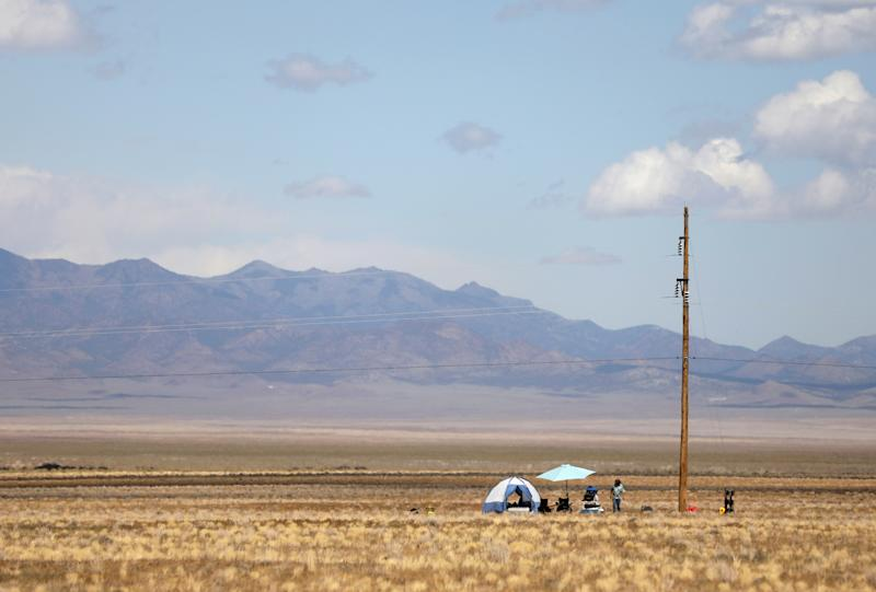 A man at his camp across from the Little A'Le'Inn as an influx of tourists responding to a call to 'storm' Area 51, a secretive U.S. military base believed by UFO enthusiasts to hold government secrets about extra-terrestrials, is expected in Rachel, Nevada, Sept. 19, 2019. (Photo: Jim Urquhart/Reuters)