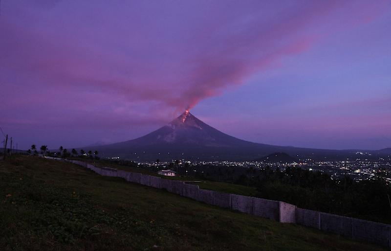 Mount Mayon spews lava and ash from its crater -- debris that experts warn could be dislodged by heavy rain (AFP Photo/Ted ALJIBE)