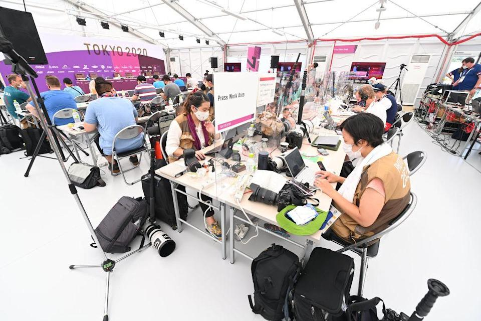 """Media Workroom for journalists and photographers with social distancing to comply with COVID19 countermeasures during the Tokyo 2020 Summer Olympic Games on July 23, 2021 in Tokyo, Japan.<span class=""""copyright"""">Vincent Kalut—Photonews via Getty Images</span>"""
