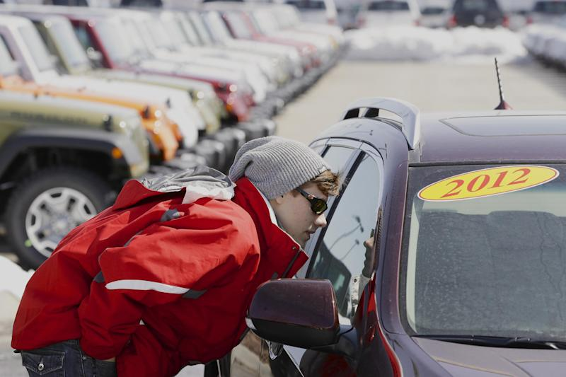 In this Thursday, March 14, 2013, photo, Matthew Miller of Omaha shops for a car in Omaha, Neb. March is turning out to be the best month for auto sales in at least six years. Major automakers including Ford, Chrysler, Toyota, General Motors and Nissan all reported increases, with some reporting their best month since the start of the Great Recession in December of 2007. (AP Photo/Nati Harnik)