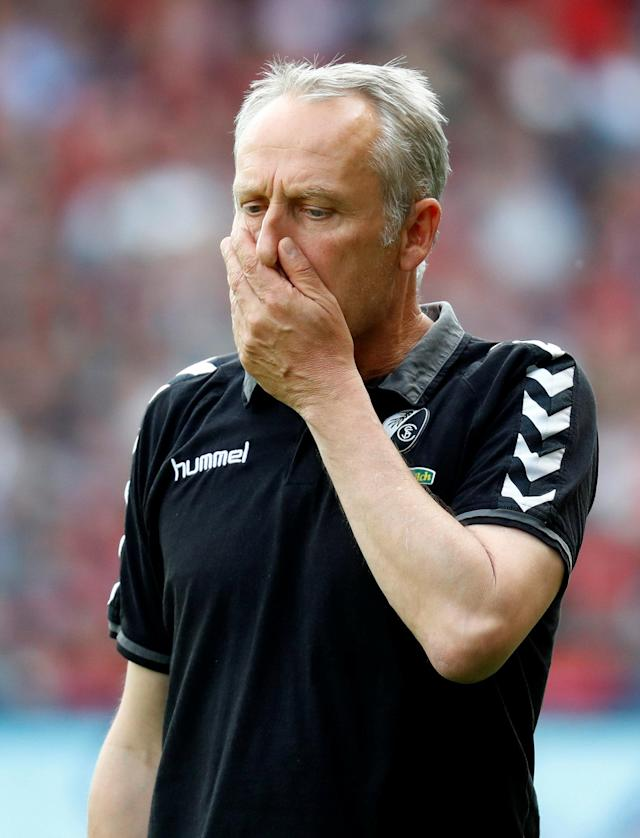 Soccer Football - Bundesliga - SC Freiburg v FC Augsburg - Schwarzwald-Stadion, Freiburg, Germany - May 12, 2018 SC Freiburg coach Christian Streich reacts REUTERS/Kai Pfaffenbach DFL RULES TO LIMIT THE ONLINE USAGE DURING MATCH TIME TO 15 PICTURES PER GAME. IMAGE SEQUENCES TO SIMULATE VIDEO IS NOT ALLOWED AT ANY TIME. FOR FURTHER QUERIES PLEASE CONTACT DFL DIRECTLY AT + 49 69 650050