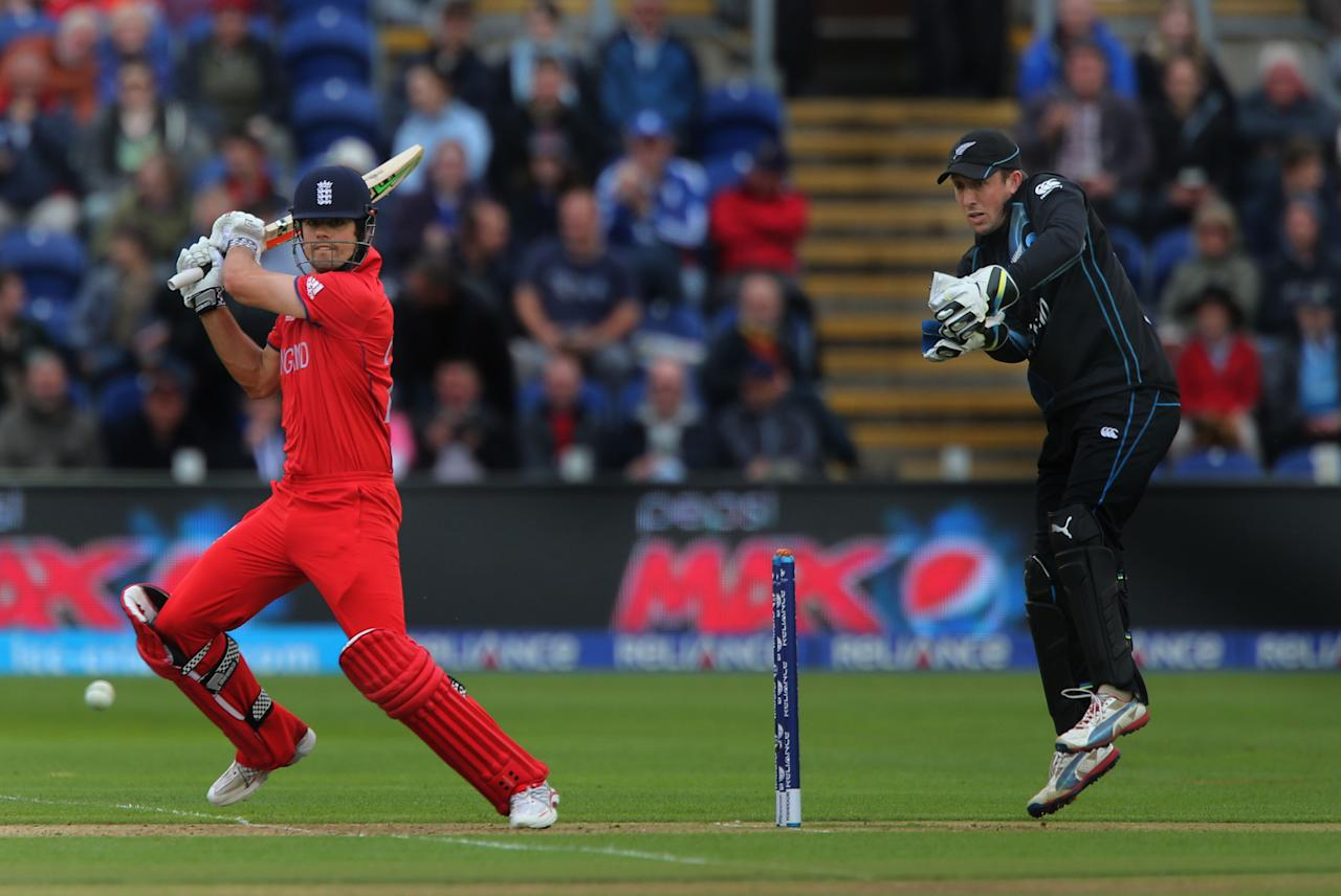 England captain Alastair Cook square cuts watched by New Zealand wicketkeeper Luke Ronchi, at the SWALEC Stadium, Cardiff.