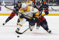 Nashville Predators' Dante Fabbro, left, and Columbus Blue Jackets' Cam Atkinson chase the puck during the second period of an NHL hockey game Wednesday, May 5, 2021, in Columbus, Ohio. (AP Photo/Jay LaPrete)