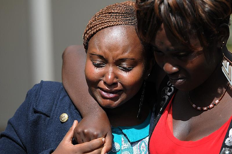 Women cry at the funeral of a person killed during the attack on Garissa University, at Mutunguru Catholic church in Kiambu on April 10, 2015
