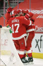 Detroit Red Wings left wing Tyler Bertuzzi, right, celebrates with defenseman Filip Hronek (17) after scoring 15 seconds into overtime to defeat the Columbus Blue Jackets in an NHL hockey game Tuesday, Jan. 19, 2021, in Detroit. (AP Photo/Duane Burleson)