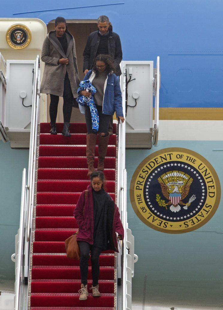 The Obama family departing Air Force One. (Photo: AP)