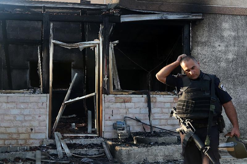 A member of the Israeli security forces inspects a Palestinian house that was set on fire by Jewish settlers in the West Bank village of Duma on July 31, 2015