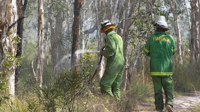 Queensland firefighters have had a brief respite from dangerous bushfire conditions
