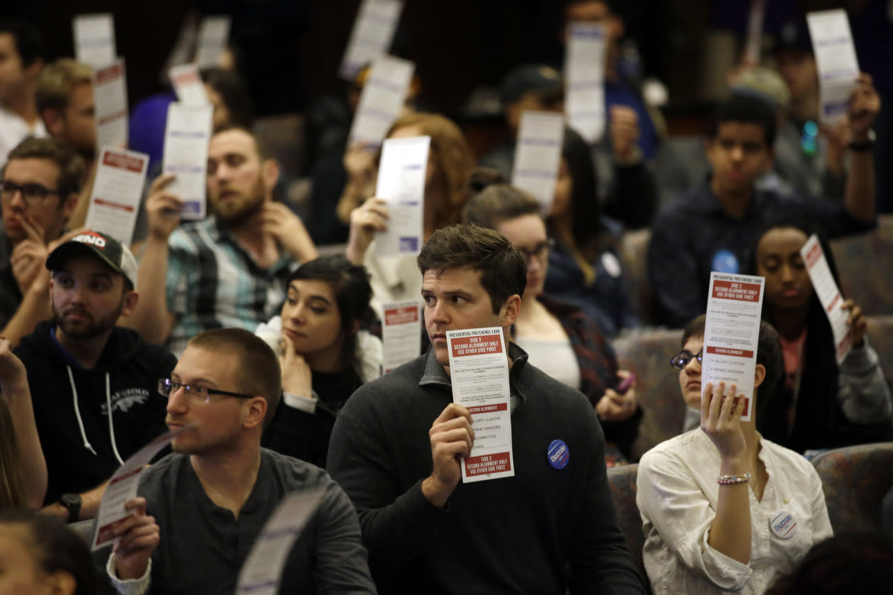 <p>Presidential preferences cards are held up as votes are counted during a Democratic caucus at the University of Nevada Saturday, Feb. 20, 2016, in Reno, Nev.<i> (Photo: Marcio Jose Sanchez/AP)</i></p>