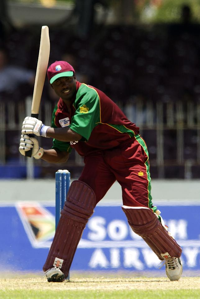 COLOMBO - SEPTEMBER 17:  Brian Lara of the West Indies hits out on his way to a century during the ICC Champions Trophy match between West Indies and Kenya held on September 17, 2002 at the Sinhalese Sports Club Stadium, in Colombo, Sri Lanka. DIGITAL IMAGE. (Photo by Tom Shaw/Getty Images)