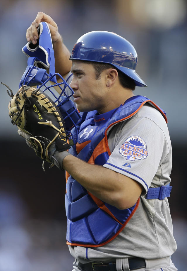 New York Mets catcher Travis d'Arnaud puts his mask back on while playing San Diego Padres during the second inning in a baseball game on Saturday, Aug. 17, 2013, in San Diego. (AP Photo/Gregory Bull)