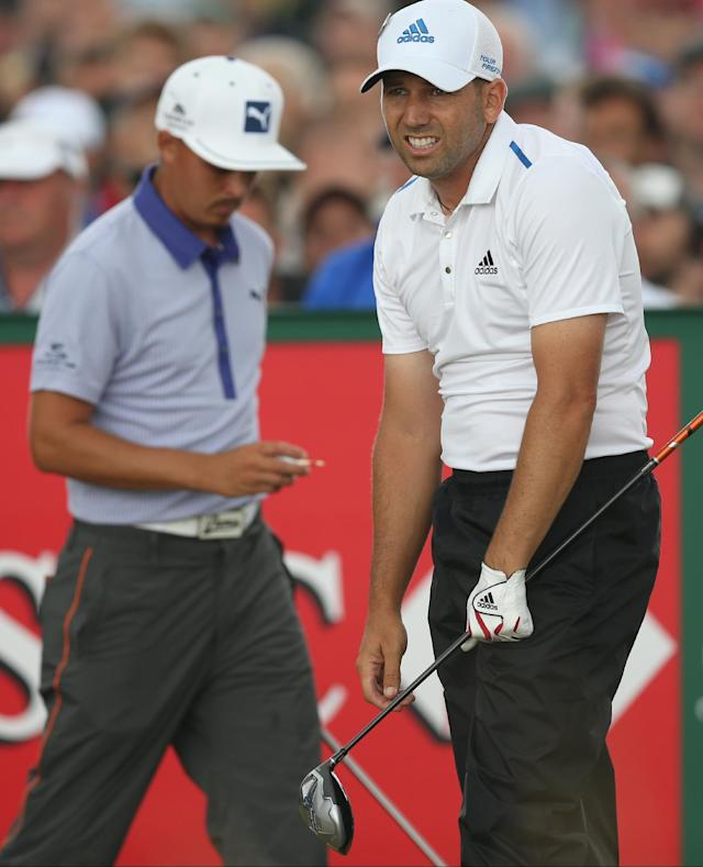 Sergio Garcia of Spain reacts after playing off the 16th tee as Rickie Fowler of the US prepares to play during the third day of the British Open Golf championship at the Royal Liverpool golf club, Hoylake, England, Saturday July 19, 2014. (AP Photo/Scott Heppell)