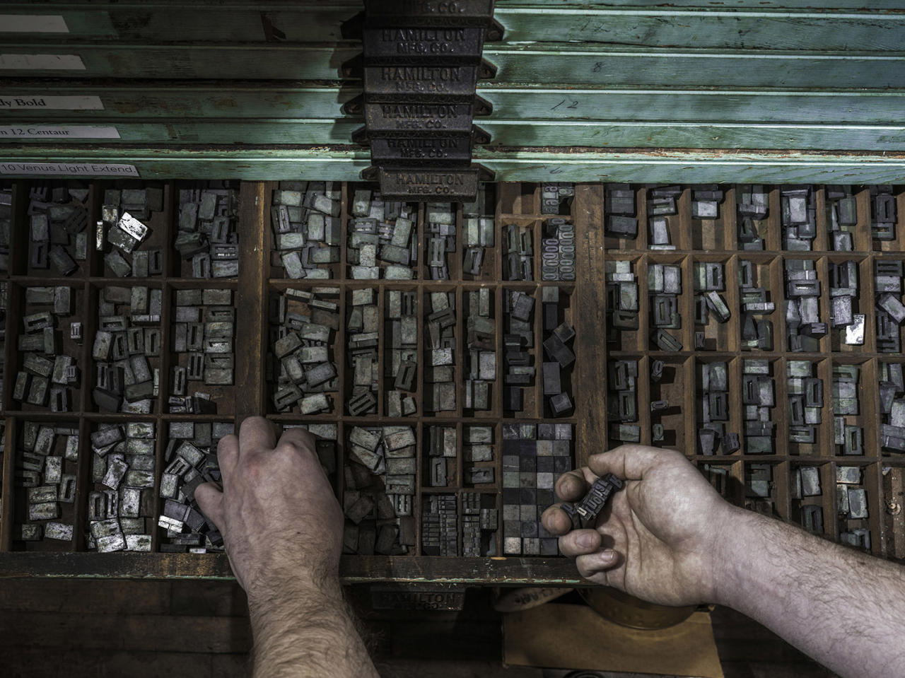 <p><strong>Nicolas — typesetter</strong><br /> With just forearms and hands showing, Sanwal's images showcase the work carried out by florists, writers and bakers; pianists, typesetters and cobblers. (Photo: Sanwal Deen/Caters News) </p>