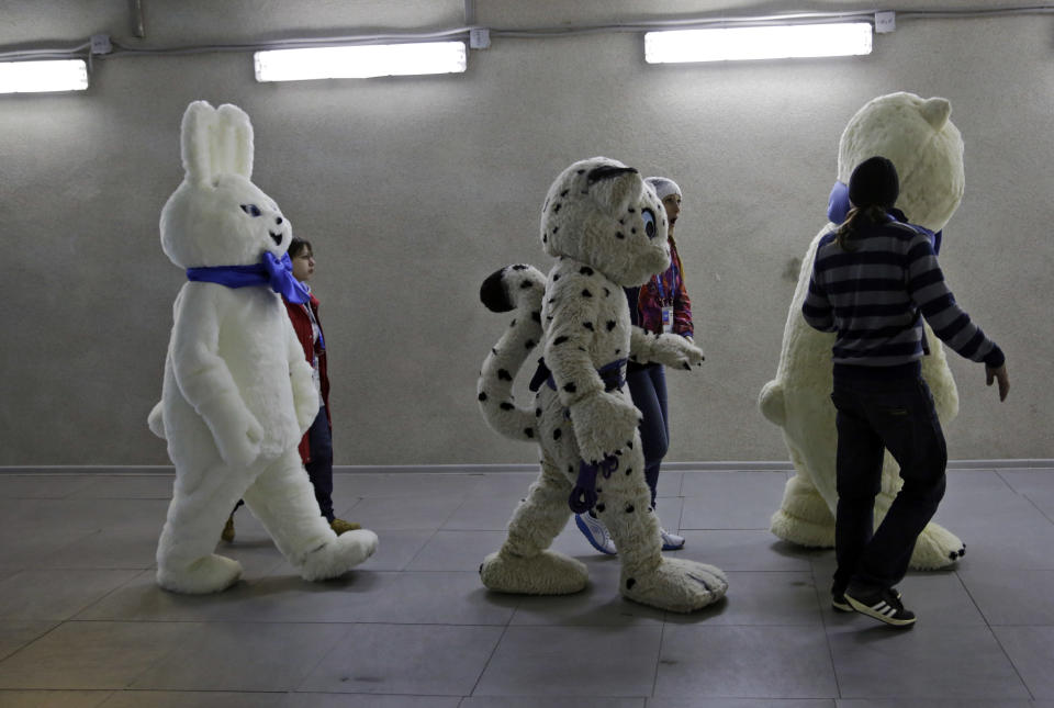 Mascots of the 2014 Winter Olympics walk out to the stadium prior to the start of the men's 500-meter speedskating race at the Adler Arena Skating Center in Sochi, Russia, Monday, Feb. 10, 2014. (AP Photo/Matt Dunham)