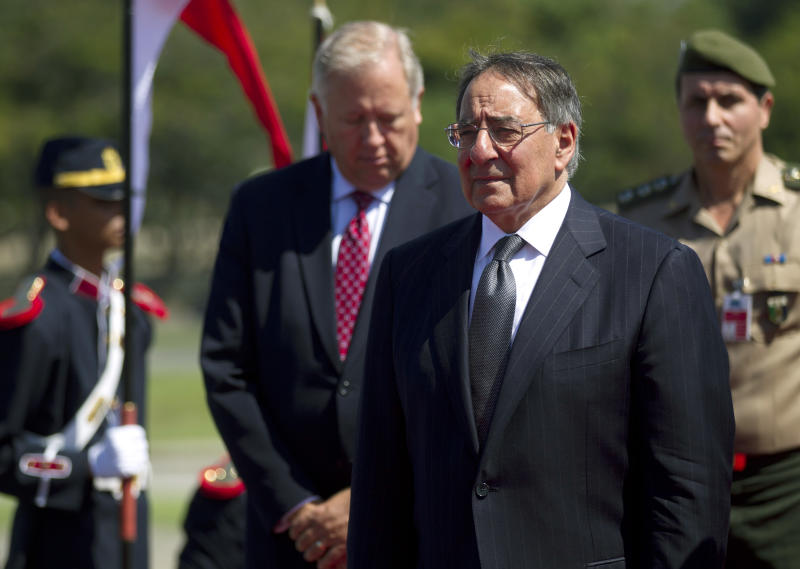 U.S. Defense Secretary Leon Panetta, right, and U.S. Ambassador to Brazil Thomas Shannon attend a ceremony in front of the Tomb of the Unknown Soldier at the National Monument for the Casualties of World War II in Rio de Janeiro, Brazil, Wednesday, April 25, 2012. (AP Photo/Silvia Izquierdo)