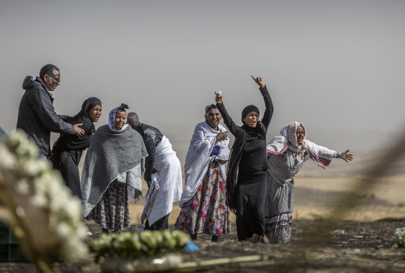 Ethiopian relatives of crash victims grieve at the site where the Ethiopian Airlines Boeing 737 Max 8 crashed shortly after takeoff on Sunday killing all 157 on board, near Bishoftu, south-east of Addis Ababa, in Ethiopia, on Thursday, March 14, 2019. (AP Photo/Mulugeta Ayene)