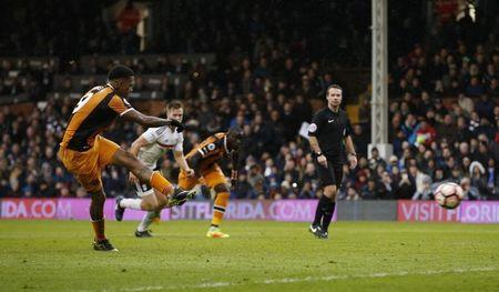 Hull City's Abel Hernandez takes the second penalty which is saved by Fulham's Marcus Bettinelli
