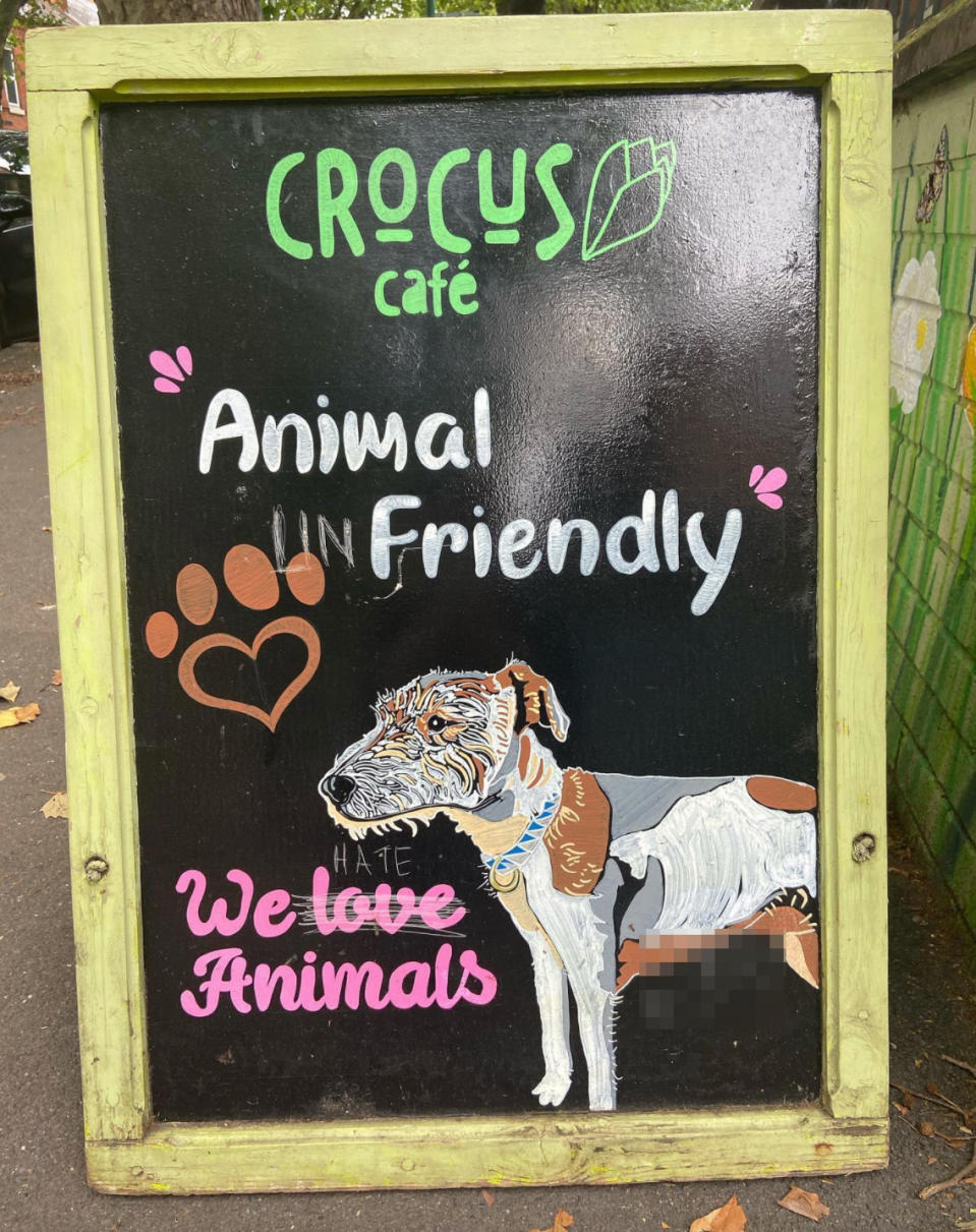 Photo shows the cafe's sign after it was vandalised.