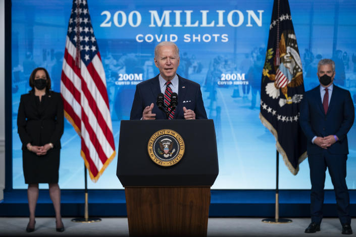 Vice President Kamala Harris, left, and White House COVID-19 Response Coordinator Jeff Zients, right, listen as President Joe Biden speaks about COVID-19 vaccinations at the White House, Wednesday, April 21, 2021, in Washington. (Evan Vucci/AP)