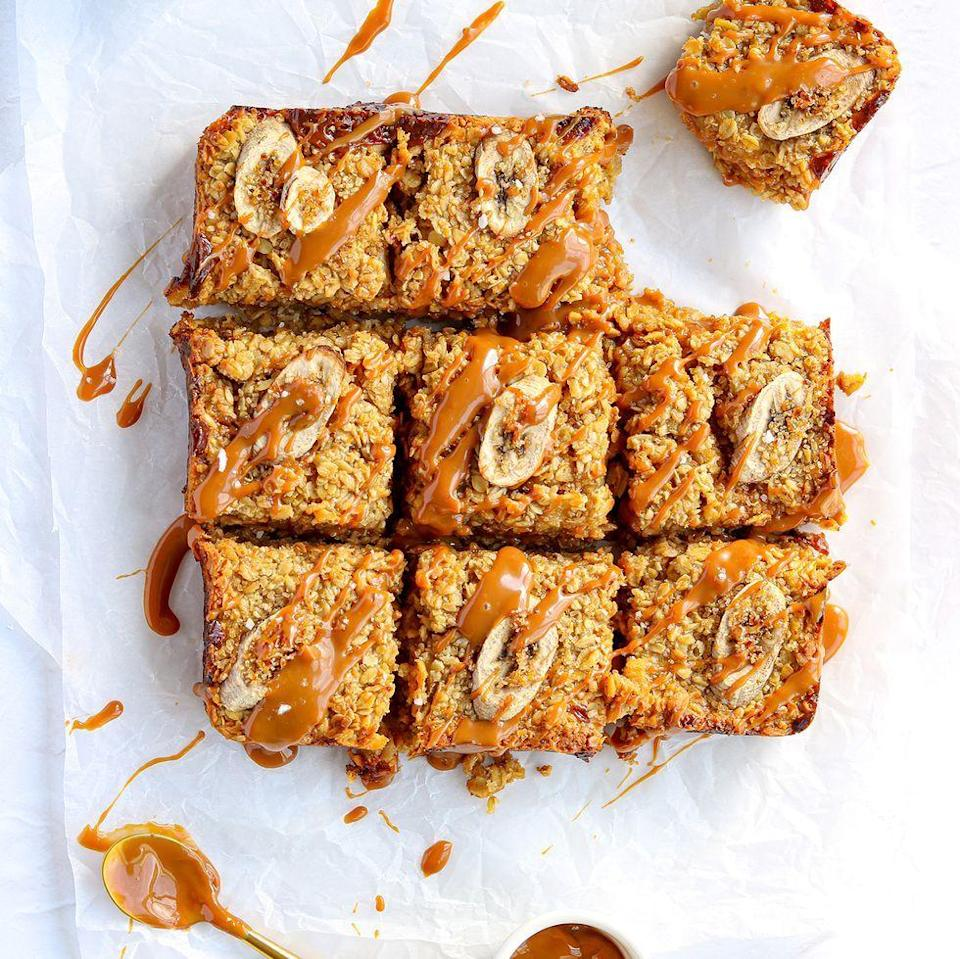 """<p>Banana <a href=""""https://www.delish.com/uk/cooking/recipes/a35486970/vegan-flapjacks/"""" rel=""""nofollow noopener"""" target=""""_blank"""" data-ylk=""""slk:flapjacks"""" class=""""link rapid-noclick-resp"""">flapjacks </a>are seriously tasty, especially when paired with <a href=""""https://www.delish.com/uk/cooking/recipes/g28842354/salted-caramel-desserts/"""" rel=""""nofollow noopener"""" target=""""_blank"""" data-ylk=""""slk:salted caramel"""" class=""""link rapid-noclick-resp"""">salted caramel</a>. We've added mashed <a href=""""https://www.delish.com/uk/cooking/recipes/g28843835/banana-bread-recipes/"""" rel=""""nofollow noopener"""" target=""""_blank"""" data-ylk=""""slk:bananas"""" class=""""link rapid-noclick-resp"""">bananas </a>to the oat mixture and sprinkled on top for added banana goodness. </p><p>Get the <a href=""""https://www.delish.com/uk/cooking/recipes/a35487496/banana-flapjack/"""" rel=""""nofollow noopener"""" target=""""_blank"""" data-ylk=""""slk:Salted Caramel & Banana Flapjacks"""" class=""""link rapid-noclick-resp"""">Salted Caramel & Banana Flapjacks</a> recipe.</p>"""