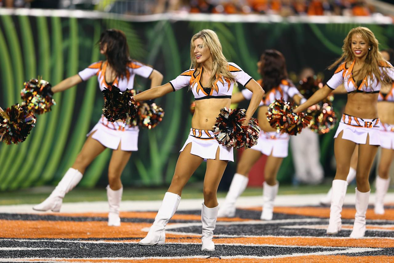CINCINNATI, OH - AUGUST 29: A Cincinnati Bengals cheerleader performs during the preaseason game against the Indianapolis Colts at Paul Brown Stadium on August 29, 2013 in Cincinnati, Ohio. (Photo by Andy Lyons/Getty Images)