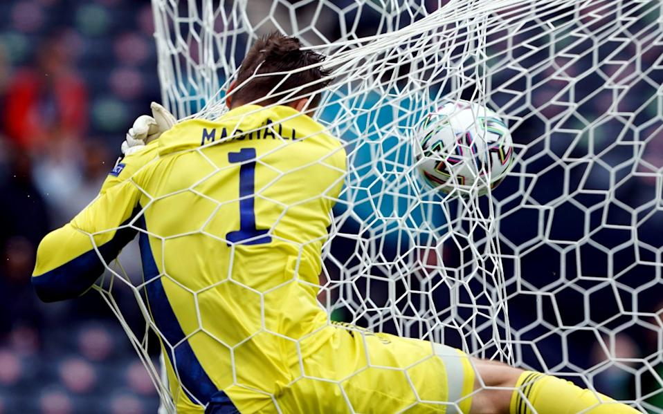 Scotland goalkeeper David Marshall crashes into the back of the net after conceding the second goal scored by Czech Republic's Patrik Schick (out of pic) during the UEFA Euro 2020 Group D match at Hampden Park, Glasgow. Picture date: Monday June 14, 2021. - Andrew Milligan/PA