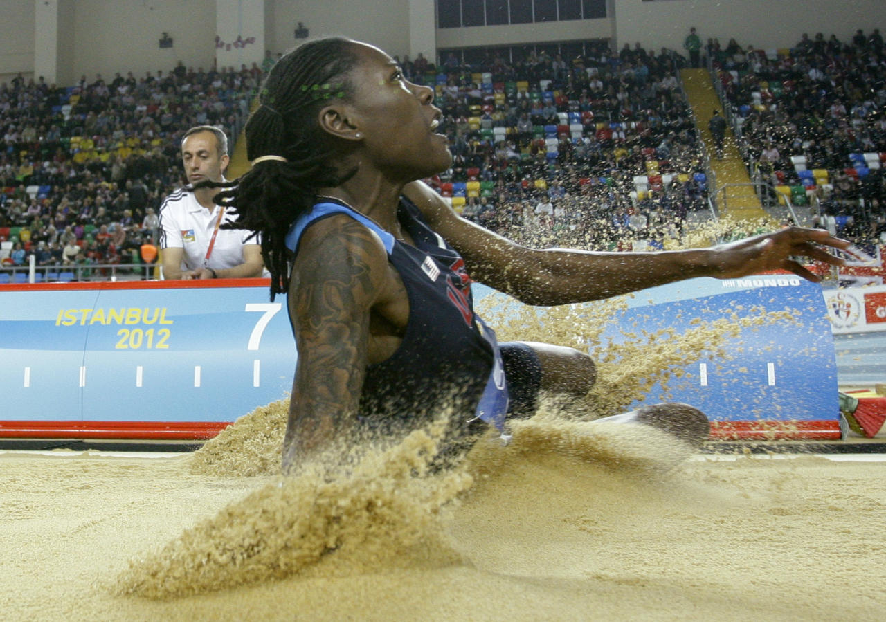 United States' Brittney Reese makes an attempt in the Women's Long Jump final during the World Indoor Athletics Championships in Istanbul, Turkey, Sunday, March 11, 2012. (AP Photo/Matt Dunham)