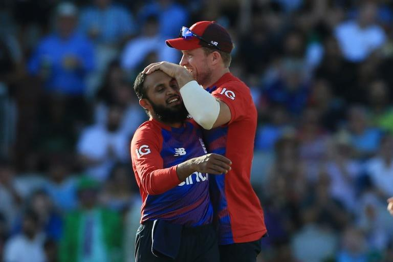 Career-best - Adil Rashid (L) celebrates dismissing Pakistan captain Babar Azam during England's three-wicket win in the 3rd T20 at Old Trafford on Tuesday