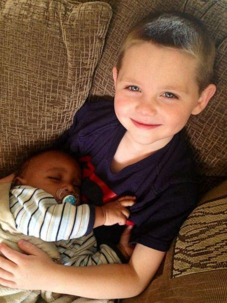 PHOTO: Scott Fessenden, 11, is seen holding his baby brother Mason. (The Fessenden Family)