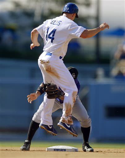 Los Angeles Dodgers' Mark Ellis, top, is tagged out at second by Colorado Rockies shortstop Jonathan Herrera to complete a double play on a ball hit by Adrian Gonzalez, who was out at first for the first out during the third inning of a baseball game, Saturday, July 13, 2013, in Los Angeles. (AP Photo/Mark J. Terrill)
