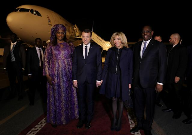 French President Emmanuel Macron and his wife, Brigitte Macron are welcomed to Dakar on February 2, 2018, by Senegalese President Macky Sall and his wife, Marieme Faye Sall in Dakar, Senegal. REUTERS/Ludovic Marin/Pool