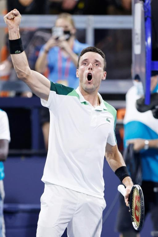 Spain's Roberto Bautista Agut celebrates after upsetting top-seeded Daniil Medvedev of Russia in the quarter-finals of the Miami Open ATP and WTA hardcourt tennis tournament