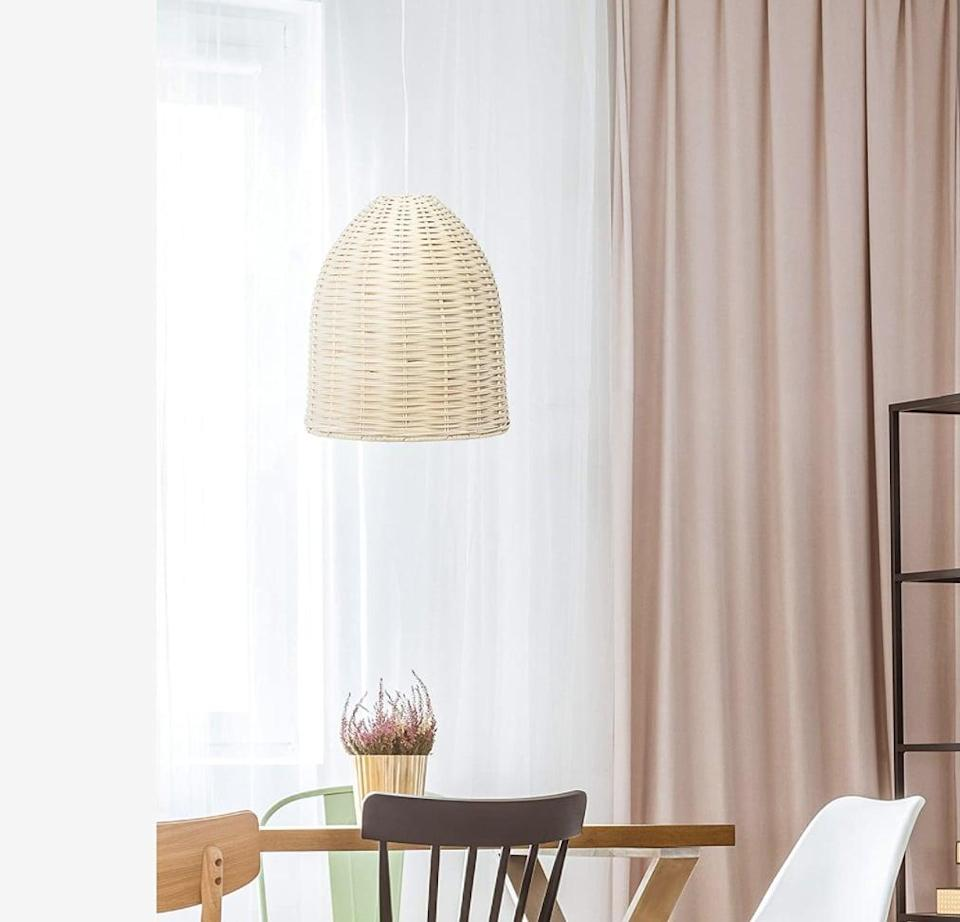 <p>Replace your old light fixture with this textured <span>Elegant Designs Rattan Ceiling Pendant</span> ($49, originally $80).</p>