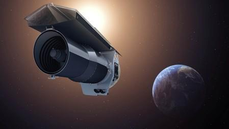 """Handout of an artist's conception showing NASA's Spitzer Space Telescope as it begins its """"Beyond"""" mission phase"""