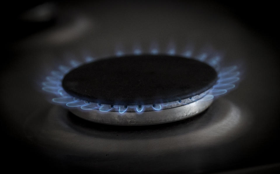 EMBARGOED TO 0001 MONDAY AUGUST 05 File photo dated 12/08/17 of a gas ring on a home cooker in London. Around 11 million households across the country are set to see their energy bills cut by between ??60 and ??80 a year, according to experts.