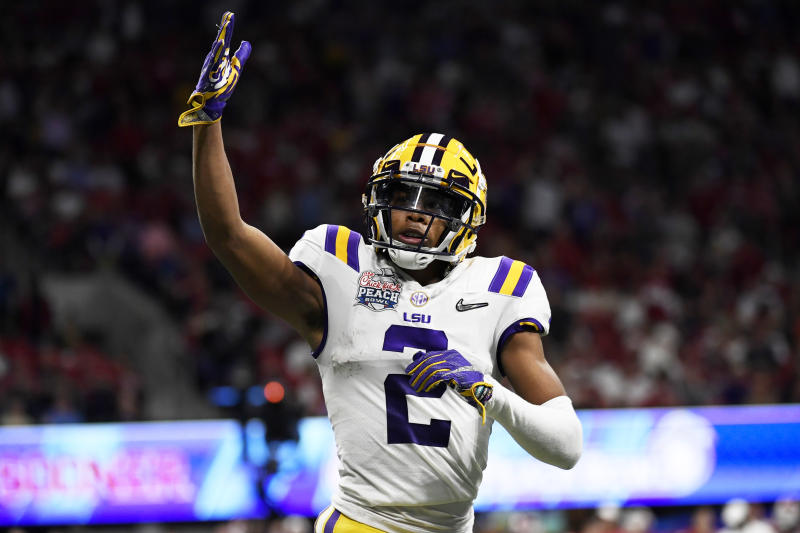 LSU wide receiver Justin Jefferson (2) celebrates his touchdown against Oklahoma during the first half of the Peach Bowl NCAA semifinal college football playoff game, Saturday, Dec. 28, 2019, in Atlanta. LSU won 63-28. (AP Photo/Danny Karnik)