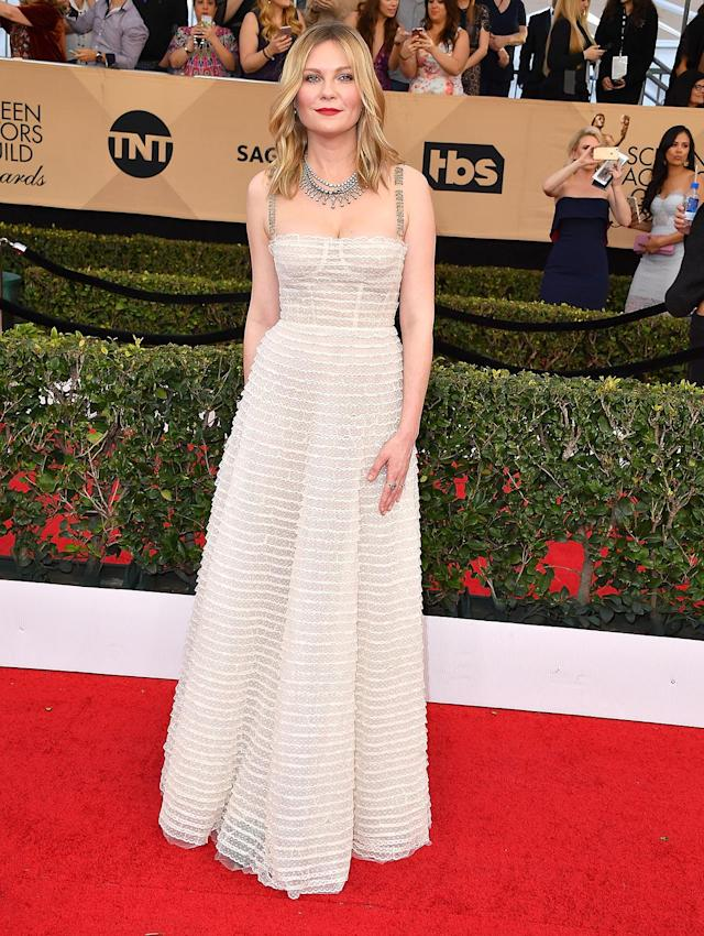 <p>Kirsten Dunst wore a cream-and-lace version of the dress to the 23rd Annual Screen Actors Guild Awards on Jan. 29. (Photo: Getty Images) </p>