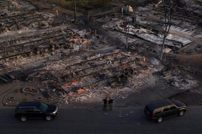 Security officials survey a neighborhood left devastated by the Almeda fire in Phoenix, Oregon.