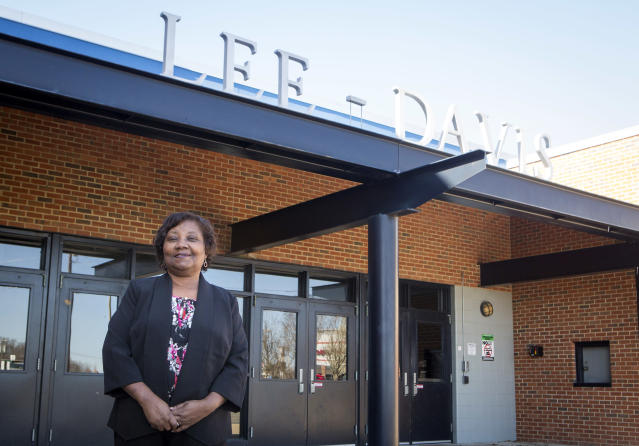 Nannie R. Davis stands for a portrait in front of Lee-Davis High School where she graduated from in 1967. Davis has always found the school name problematic and has been vocal about her support of the name change. (Julia Rendleman/Getty Images)