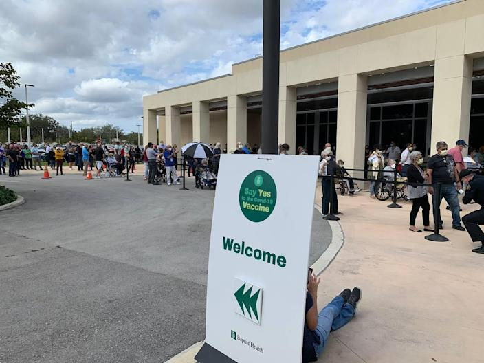 On the first day Baptist Health began administering the COVID-19 vaccination, lines formed at the site on the Hilton grounds on the hospital's Kendall campus on Jan. 11, 2021.