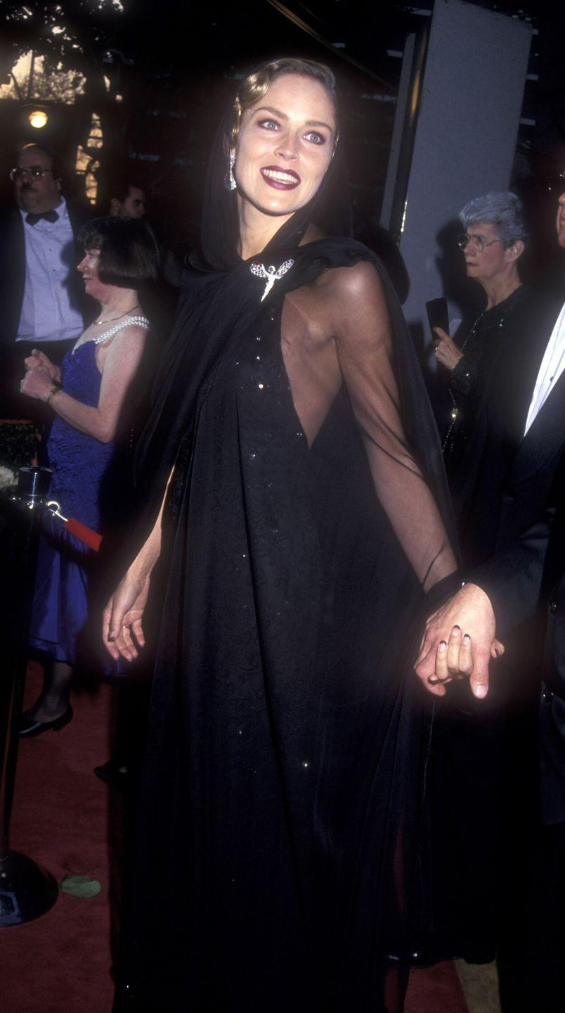 <p>The dramatic veil and whimsical brooch only made this sheer number more memorable. Sharon went to present the award for Best Costume Design later that night.</p>