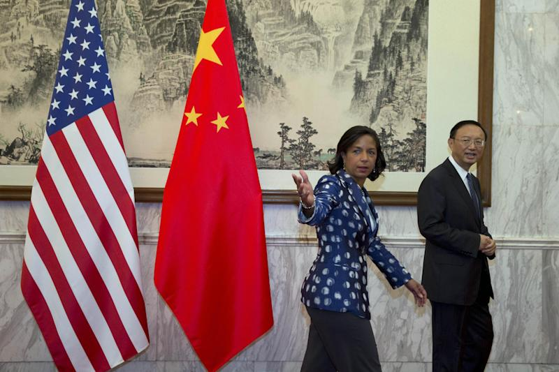 US National Security Advisor Susan Rice gestures and Chinese State Councilor Yang Jiechi before their meeting at the Diaoyutai State Guesthouse in Beijing on September 8, 2014 (AFP Photo/Ng Han Guan)