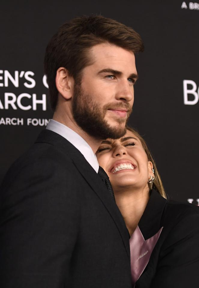 """<p>Miley and Liam cuddled up at the Women's Cancer Research Fund's <a href=""""https://www.popsugar.com/celebrity/Miley-Cyrus-Liam-Hemsworth-Cancer-Research-Fund-Gala-2019-45867069"""" class=""""ga-track"""" data-ga-category=""""Related"""" data-ga-label=""""https://www.popsugar.com/celebrity/Miley-Cyrus-Liam-Hemsworth-Cancer-Research-Fund-Gala-2019-45867069"""" data-ga-action=""""In-Line Links"""">Unforgettable Evening Gala</a> in Feb. 2019.</p>"""