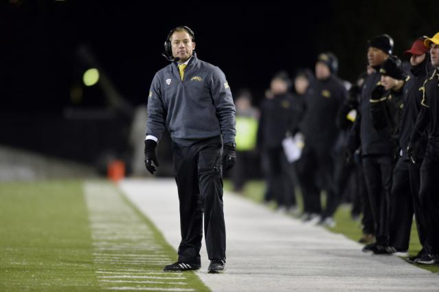 DEKALB, IL - NOVEMBER 26: Head coach P. J. Fleck of the Western Michigan Broncos stands on the sidelines during the third quarter against the Northern Illinois Huskies at Huskie Stadium on November 26, 2013 in DeKalb, Illinois. Northern Illinois defeated Western Michigan 33-14. (Photo by Brian Kersey/Getty Images)