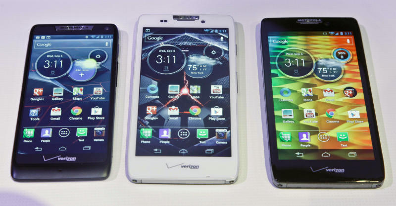 Motorola's three new Droid Razr smartphones, the Droid Razr M, center, the Droid Razr HD, center, and the Droid Razr Maxx HD, are unveiled at a press conference on Wednesday, Sept. 5, 2012.  The phones are the first from Motorola as a part of Google.  (AP Photo/Bebeto Matthews)